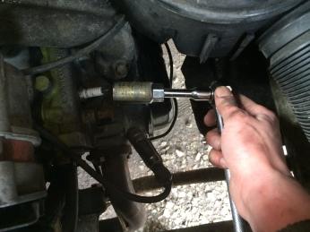 Removing a spark plug