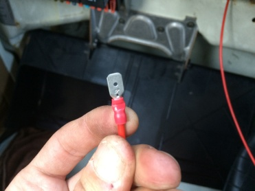 Spade connector crimped to cable