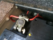 Bolted in place and inline fuse poked under passenger seat