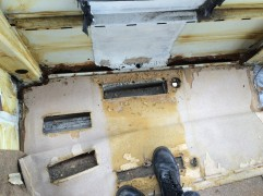 The section between floor and side panel has completely rotted away