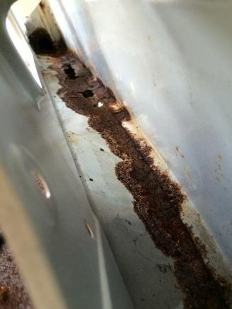Nearside wheel arch rust