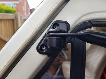 Guide holes drilled for upper bracket screws